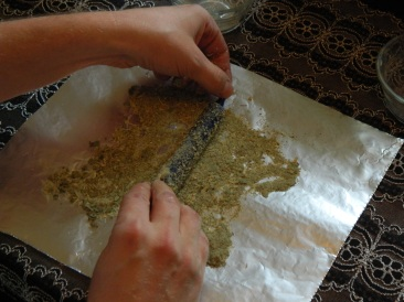 Rolling Dressed Candle In Herb Mix